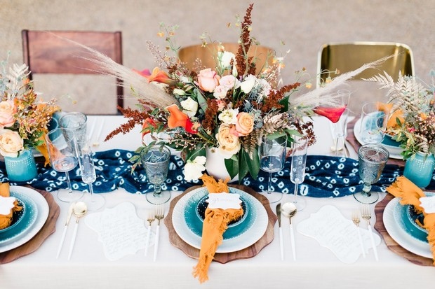 teal and gold wedding place settings