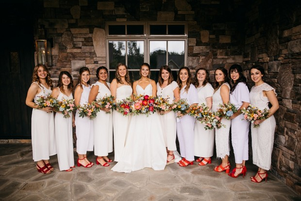 bridesmaids in white jumpsuits