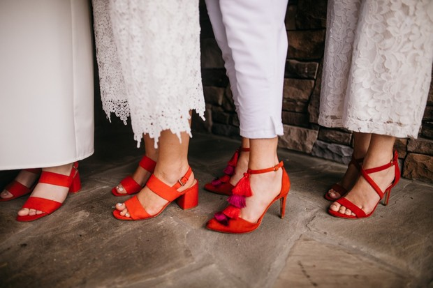 bridesmaids in red shoes