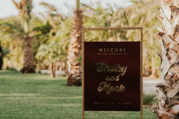 gold and burgundy wedding sign