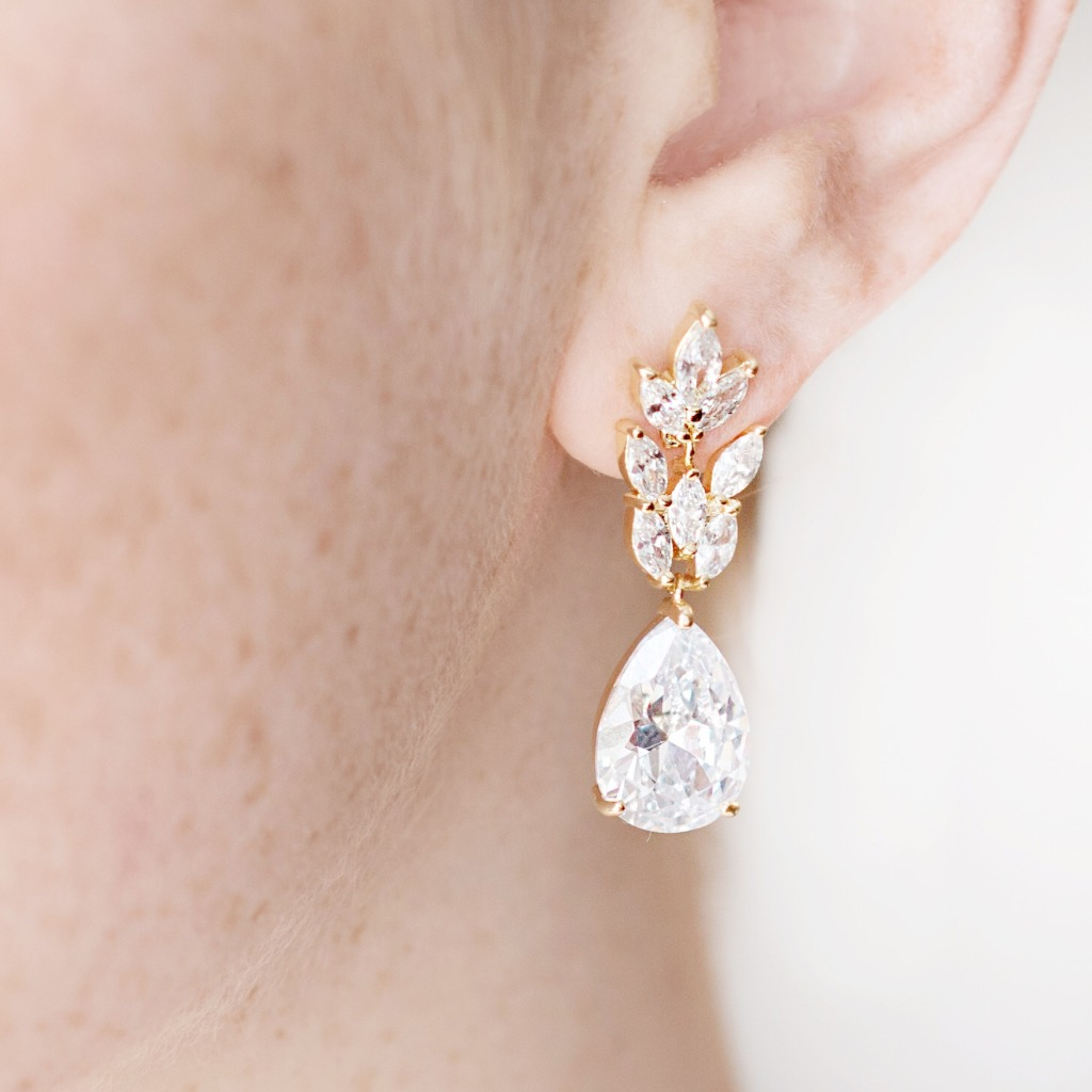 These beautiful, elegant teardrop bridal earrings dangle delicately from a crystal leaf motif. Achieve the look of a classic bride