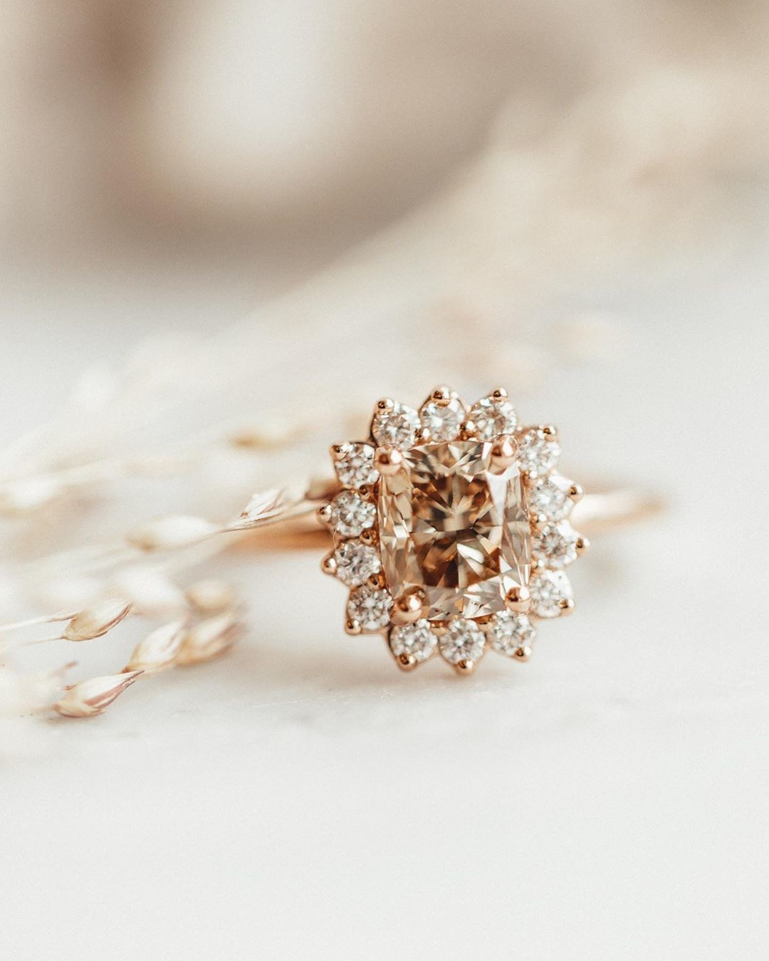 We had such a wonderful time designing this cushion cut champagne diamond ring with a starburst halo in 14k rose gold with Matthew