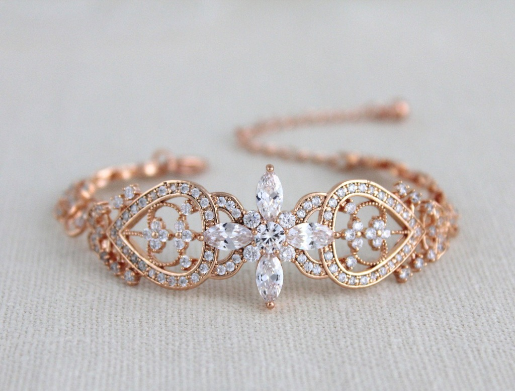 A cuff bracelet is always a bold statement. This vintage cuff is ornate and covered in Swarovski Pure Brilliance stones in a crisscross