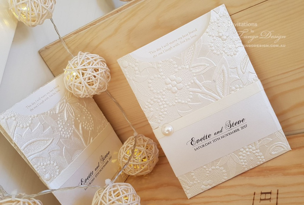 100's of gorgeous embossed papers made into custom invitations