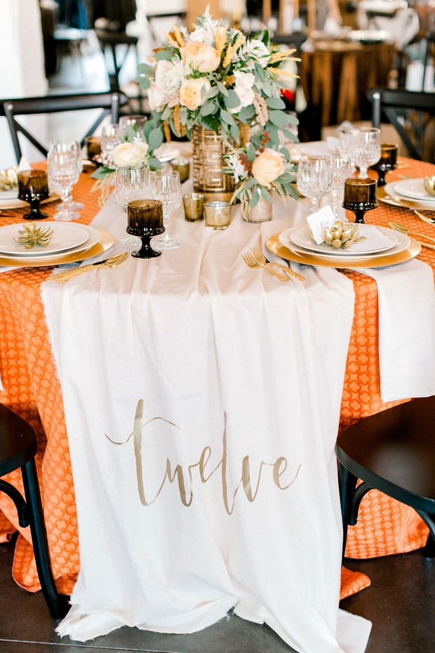 midcentury modern orange and gold table decor