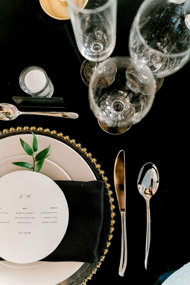 gold and black modern place setting