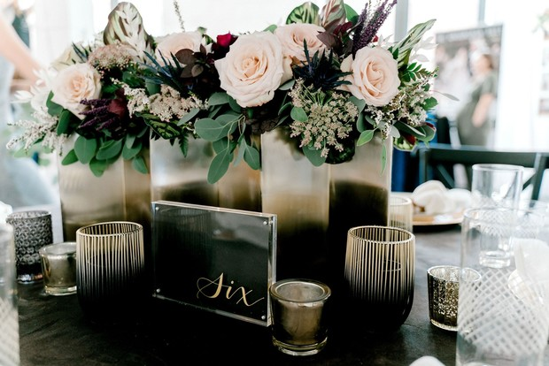 modern and masculine table number and centerpiece