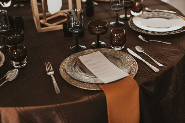 silver and burnt orange place setting
