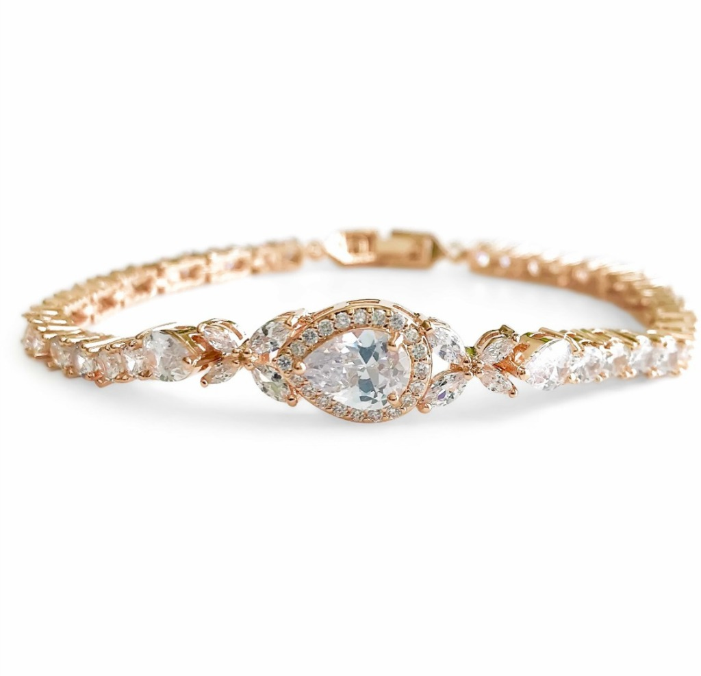 This beautiful wedding bridal bracelet features a sparkling teardrop pendant surrounded by cubic zirconia crystals. The perfect sparkling