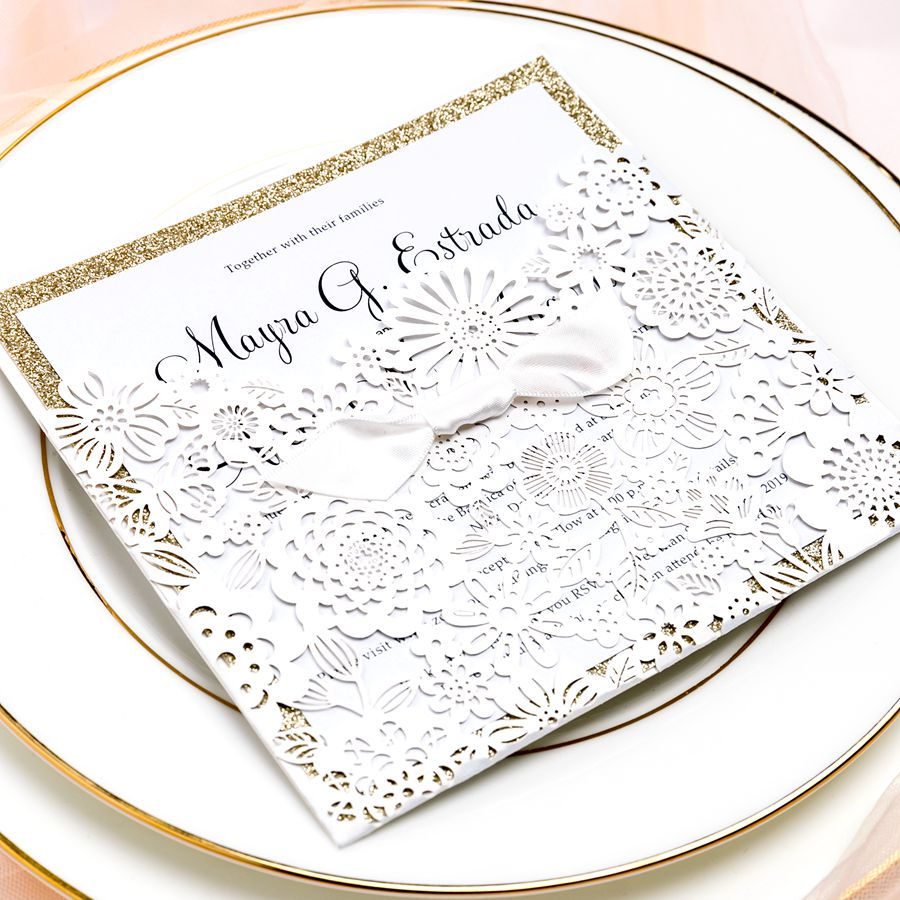 This square invite stands out with 3/4 floral pocket and finished with a tiny cute ribbon shaped like a tie. The cover embraces delicate