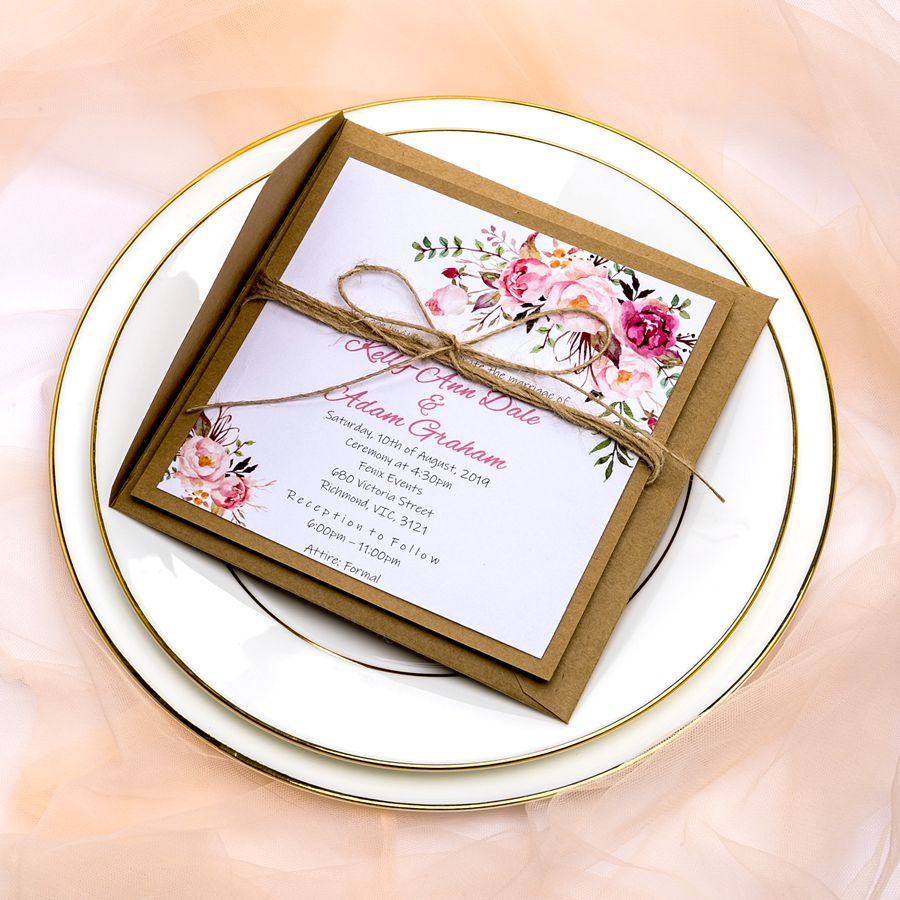 This understated invite decorated with blush blooms at corners is really chic for country or garden days. The handmade twine brings