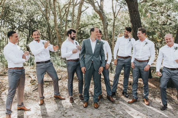groom and groomsmen in grey and white