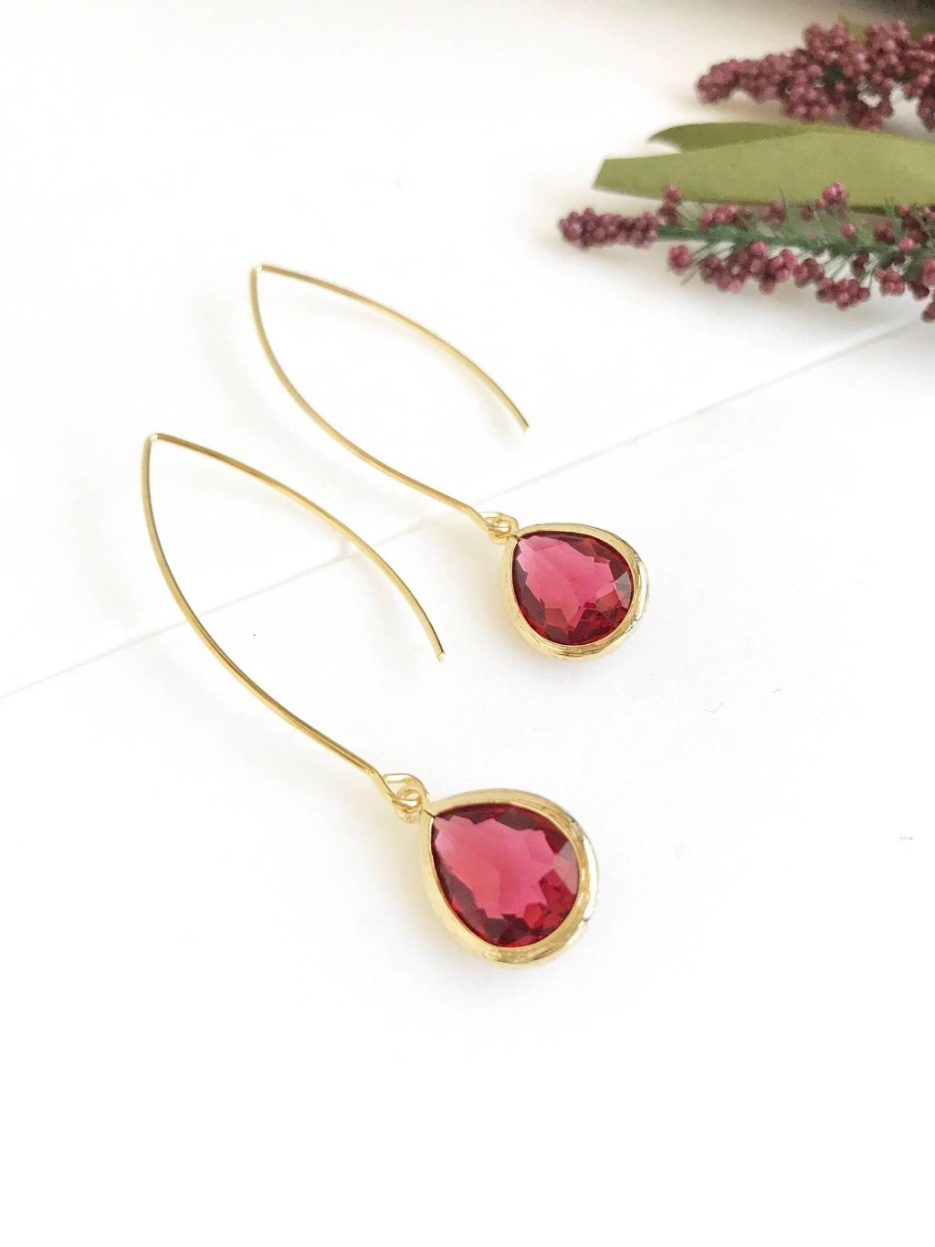 Ruby red and gold are paired beautifully in these elegant and stunning earrings. Alive and gorgeous, these earrings will add a beautiful