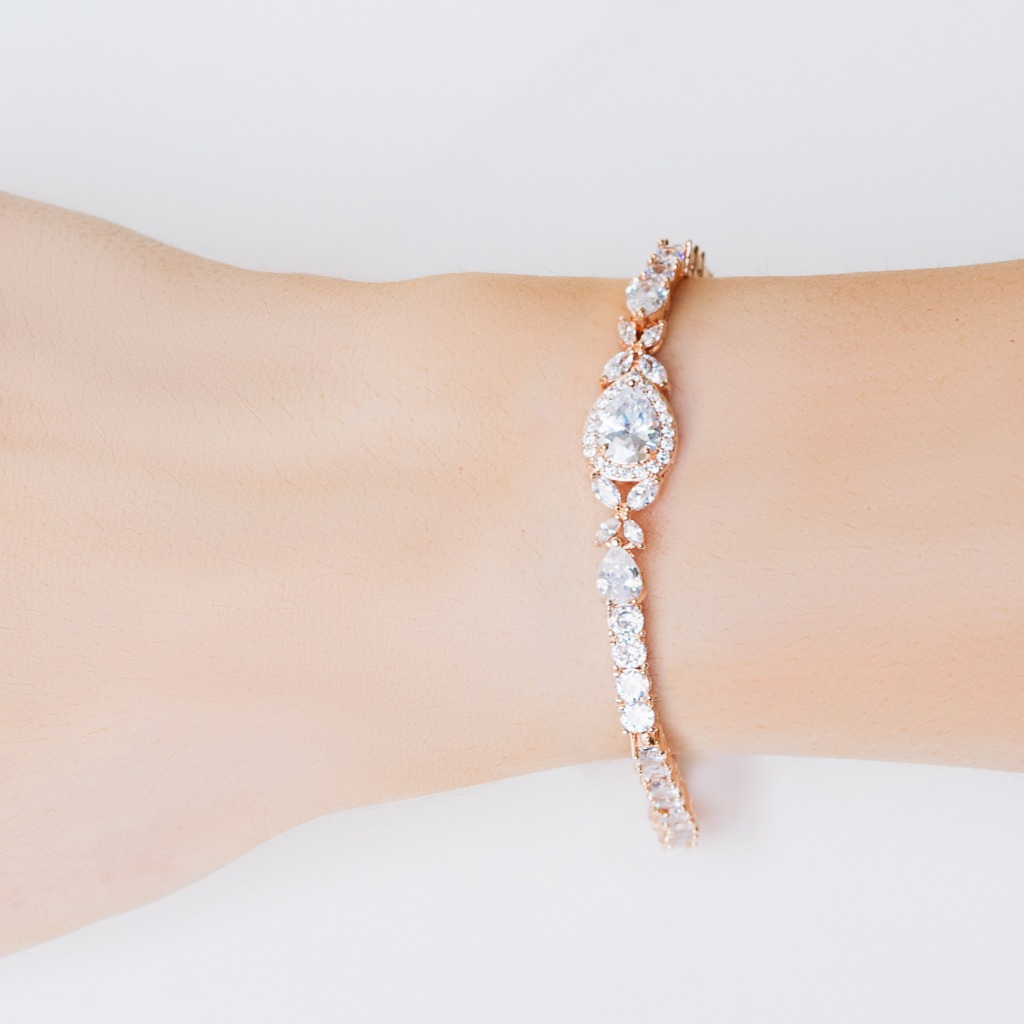 The Isabella Wedding Bracelet features a sparkling teardrop pendant surrounded by cubic zirconia crystals. The perfect sparkling bridal