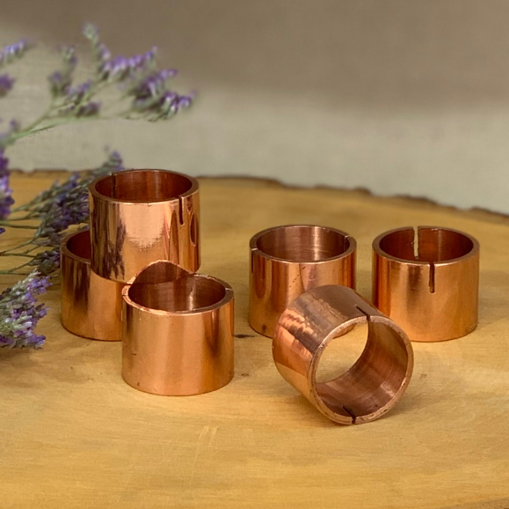 These metallic rose gold place card holders are beautifully polished so that the warm rose gold glow catches and reflects the light