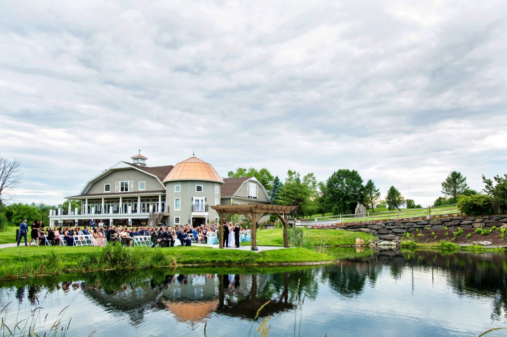 Beautiful summer wedding ceremony by the pond at Sussex County, New Jersey wedding venue, Bear Brook Valley.