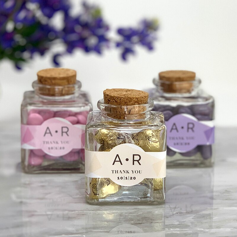 These personalized square favor jars add a modern detail to your wedding reception, anniversary, bridal shower or celebration. Each