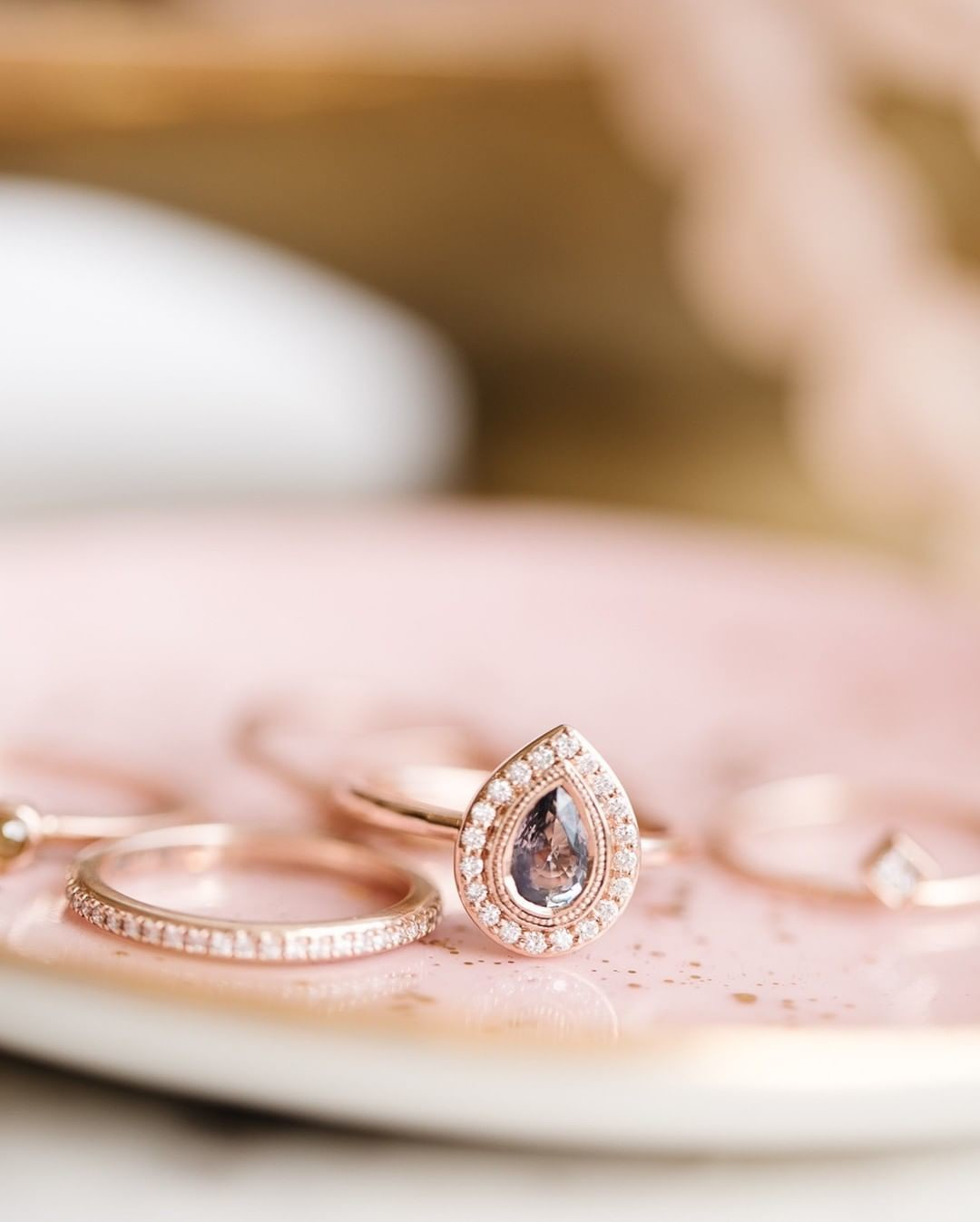 How stunning does our pear sapphire ring with a pave diamond halo look in this