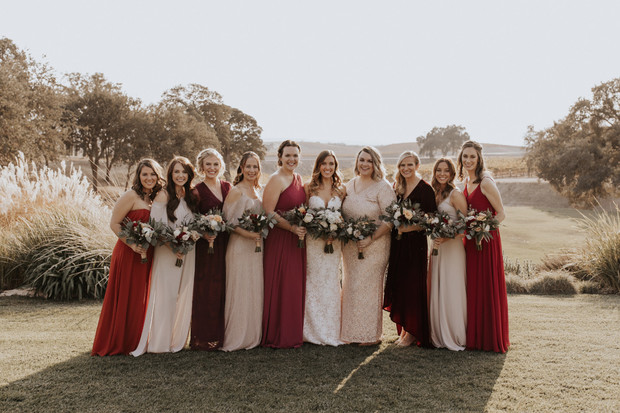 bridesmaids in red and blush dresses