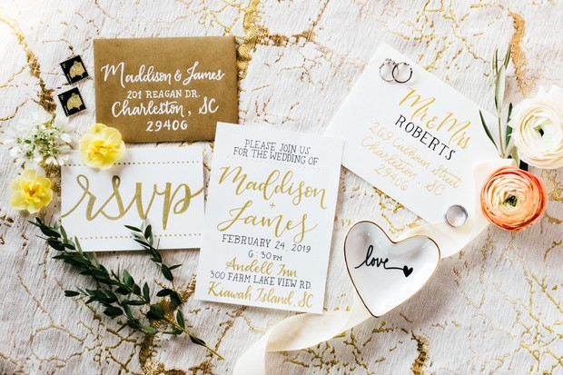 gold and white calligraphy wedding invitation suite