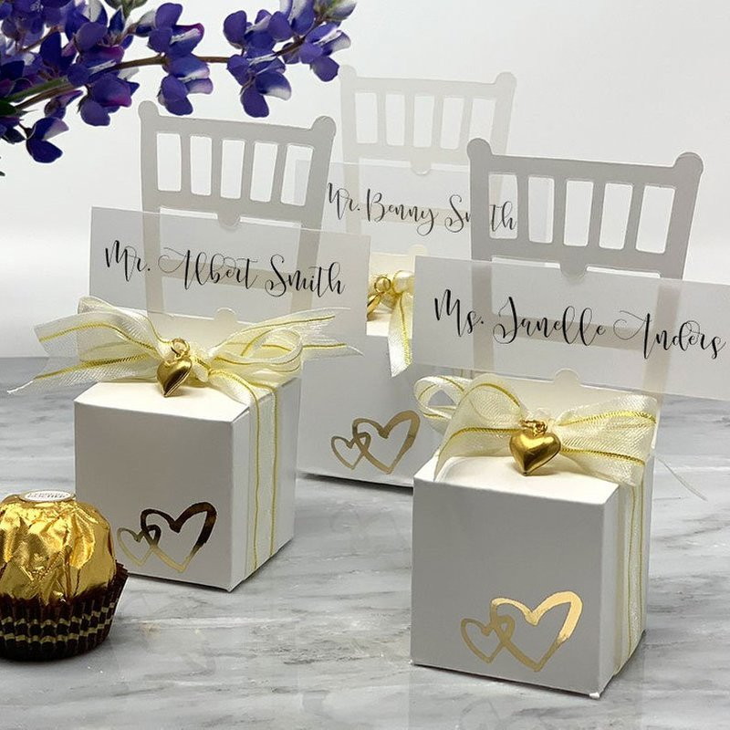 Two gold foil hearts on the front of our white chair favor box adds a romantic, modern finish to this both a wedding favor and a place