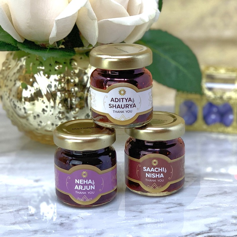 Offer your guests a thoughtful favor with these Indian Wedding themed strawberry jam favor jars that are sure to be a sweet complement
