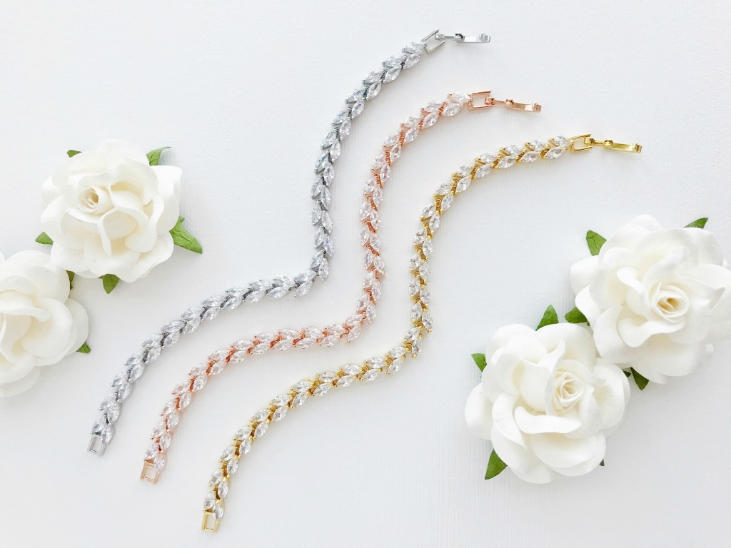 The Madelyn Wedding Bracelet is available in gold, rose gold and silver. Add some sparkle to your wedding look or gift some sparkle