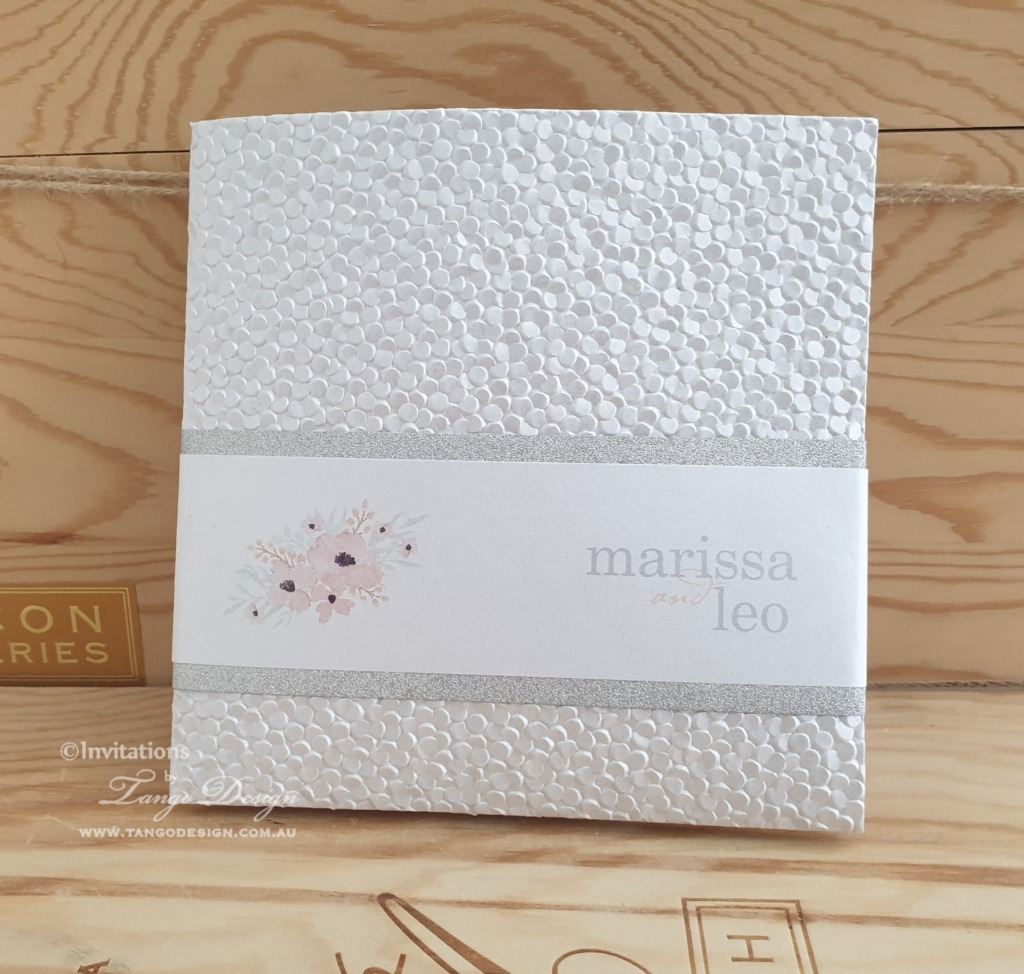 Pocketfold with embossed paper