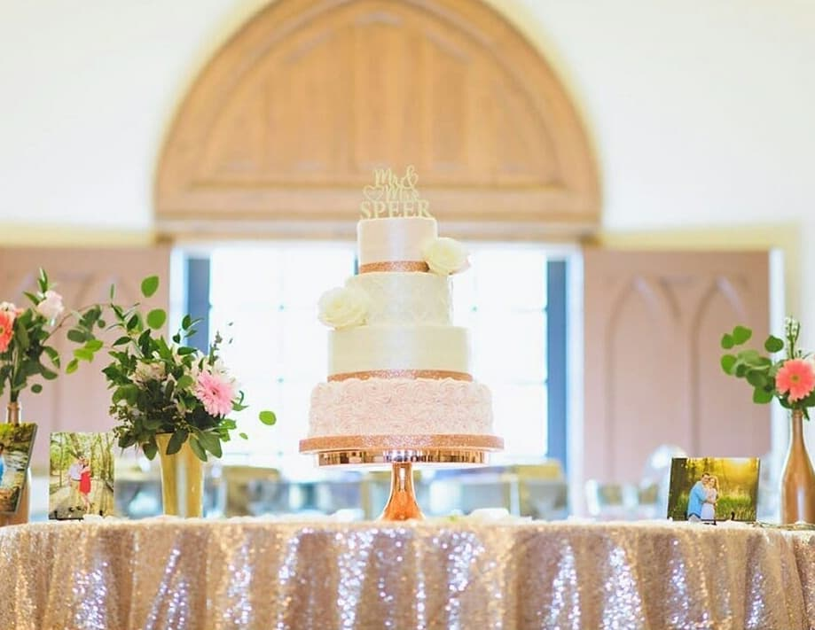 Rose gold details make for the perfect metallic wedding décor. Your wedding cake table, and all the personal touches you add to it