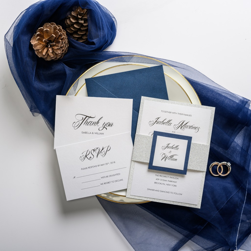 Classic navy blue wedding invitation with silver shimmering belly band and blue edged tag, perfect for modern black-tie nuptials. Use