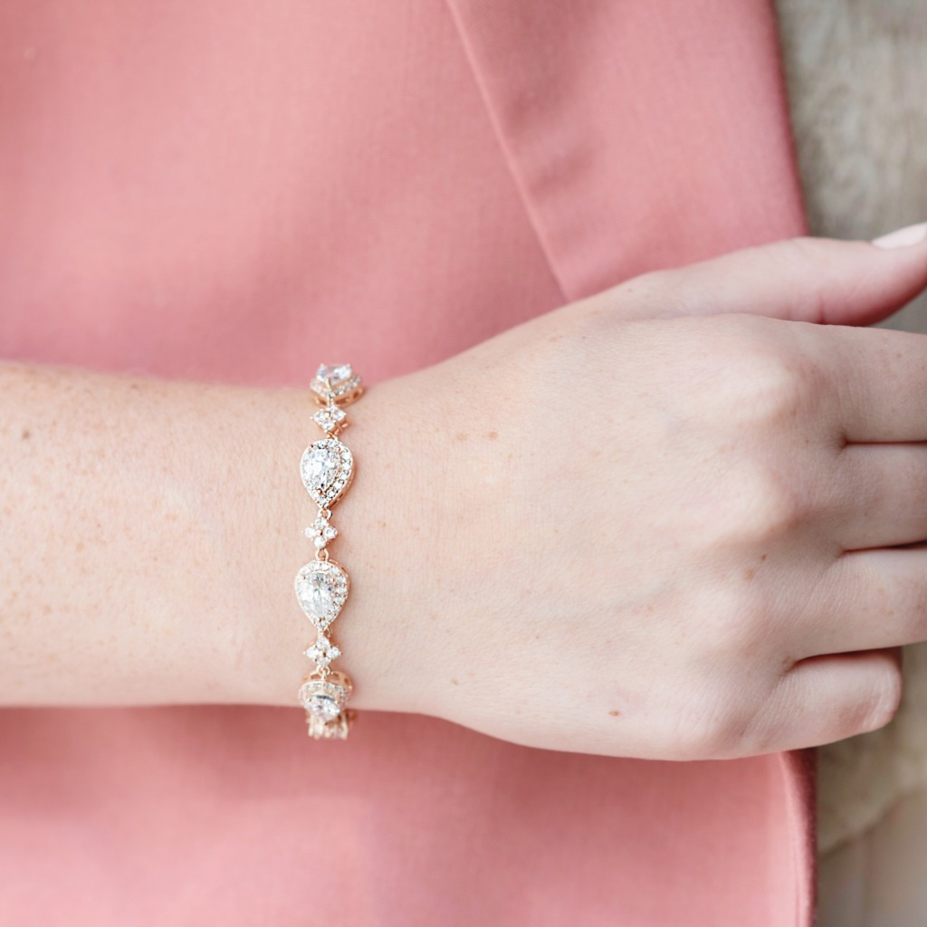 The Celeste Wedding Bracelet features cubic zirconia crystal in teardrop and star patterns that sparkle in the light. Find more great