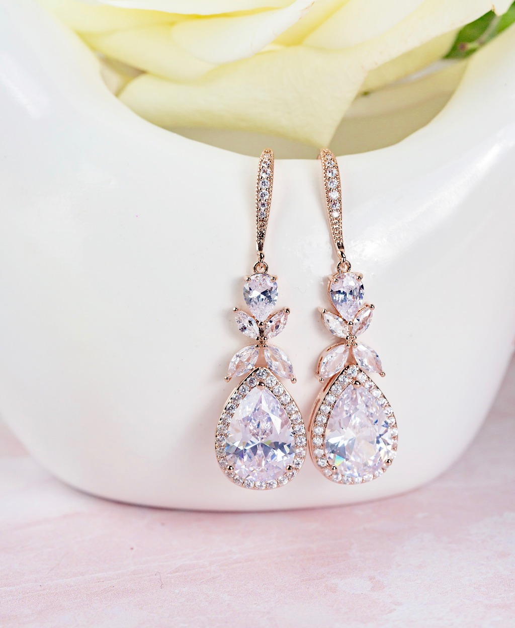The Isabella Bridal Earrings are a classic teardrop wedding earring available in rose gold and silver. You'll feel like royalty in