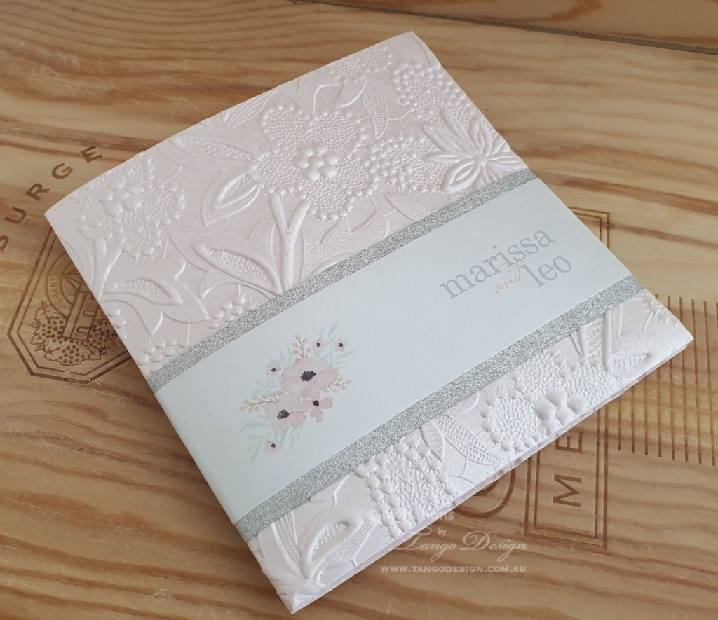 Check out our portfolio with blush touches and embossed paper