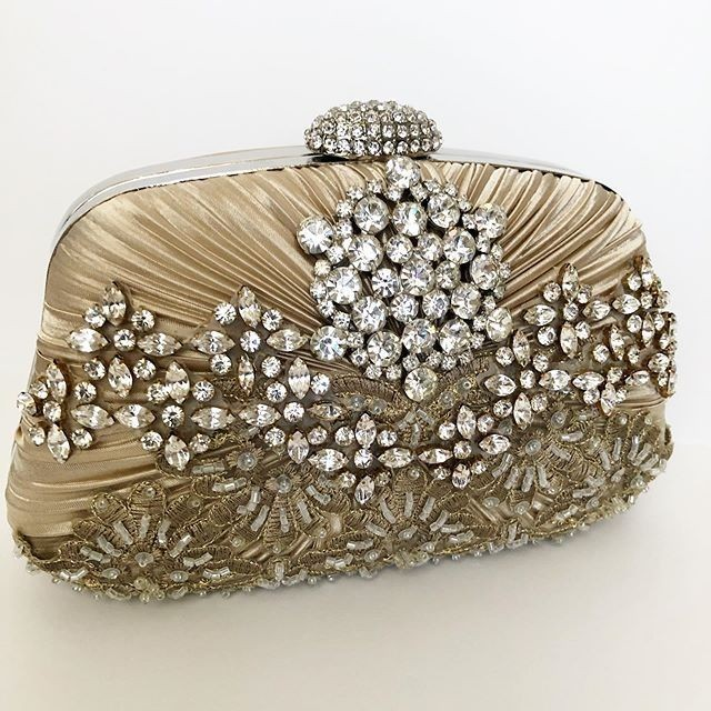 Rhinestone details that make this evening clutch so glamorous. Perfect for the