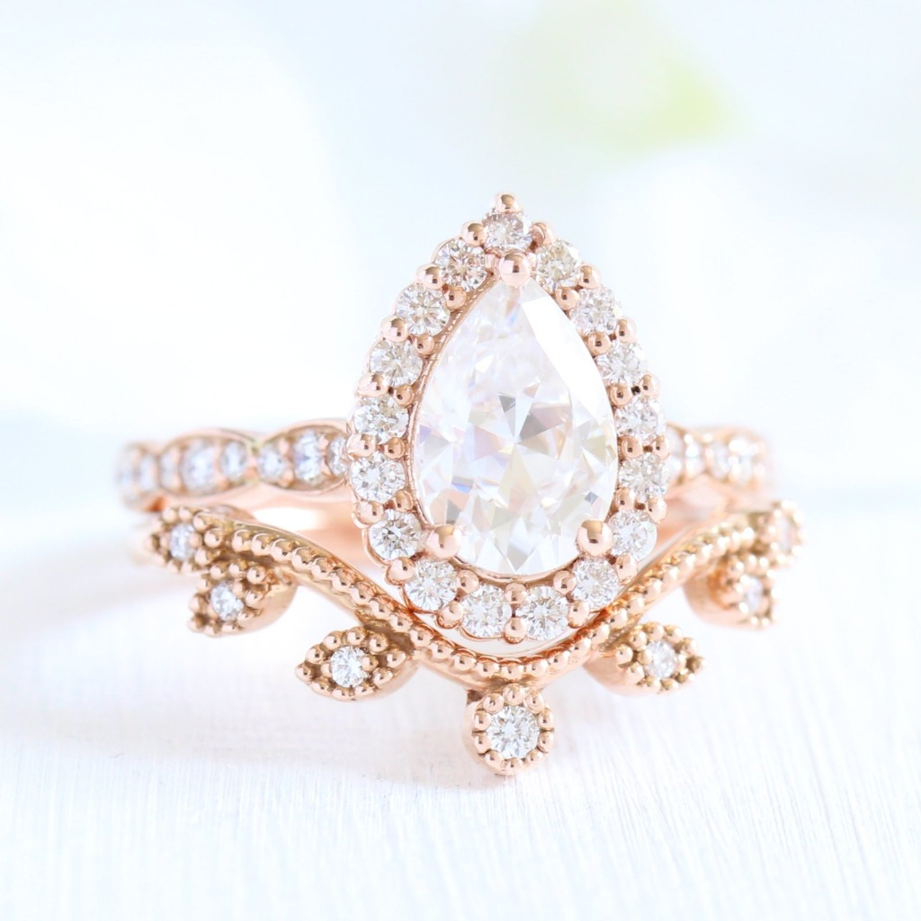 Classic and timeless bridal set! Artfully crafted moissanite ring bridal set of a pear cut moissanite engagement ring in rose gold