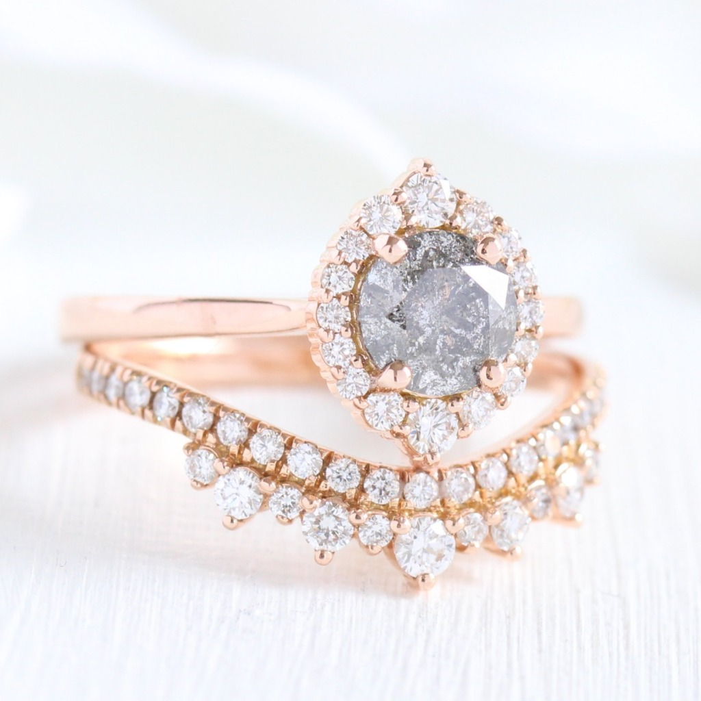 Breathtakingly gorgeous and unique! This diamond bridal set features a grey diamond engagement ring in tiara halo diamond ring setting