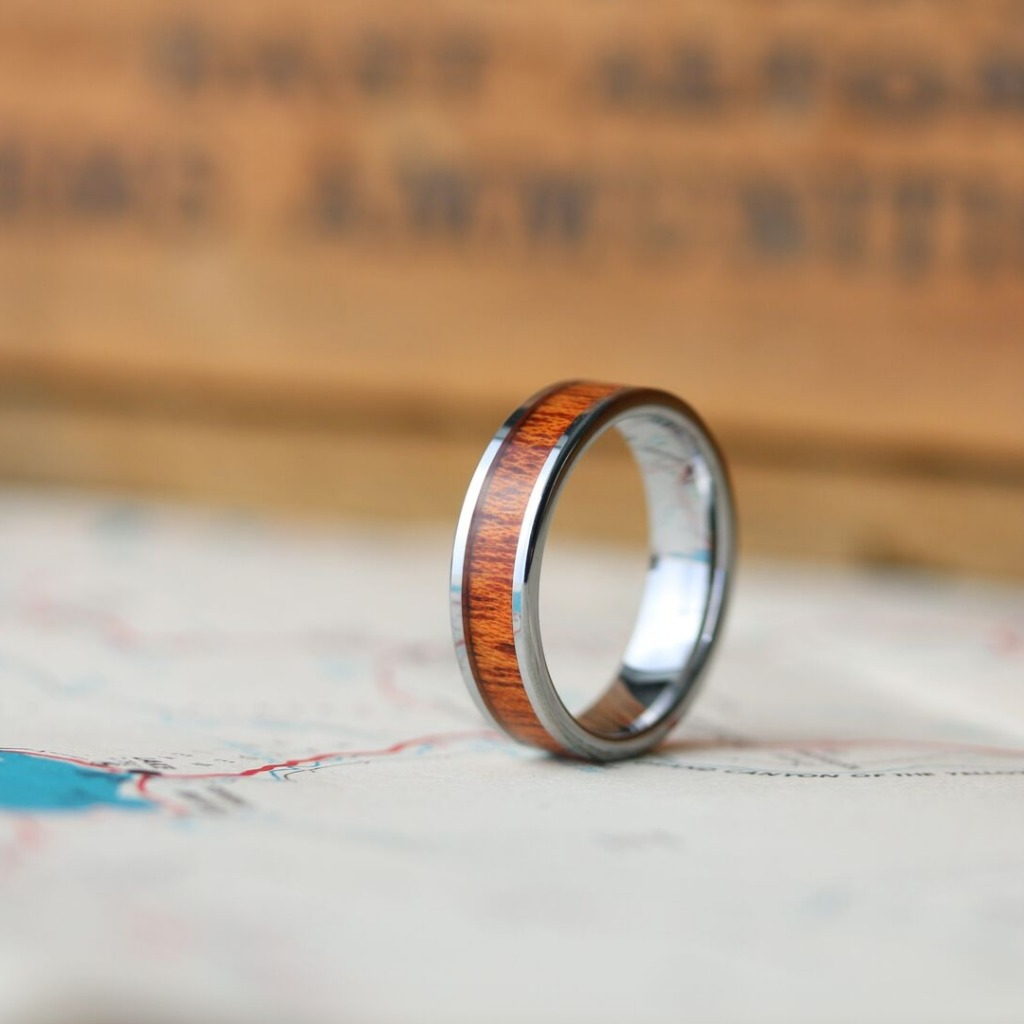 The Silver Wooden Ring - This mens wedding ring is crafted out of high-grade tungsten carbide and inlaid with natural koa wood. Available