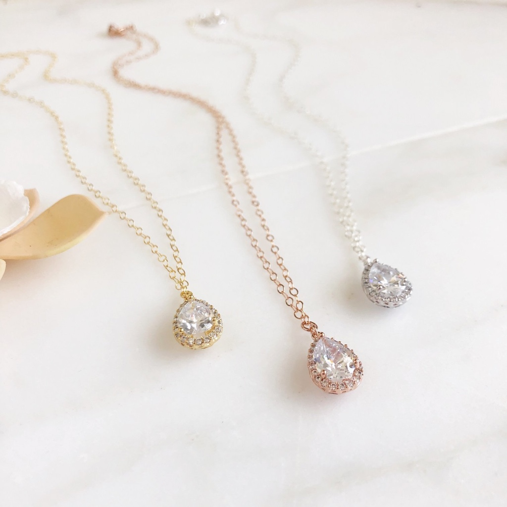These sweet CZ teadrop necklaces are 18 long on 14k rose gold filled chain, 14k yellow gold filled, and sterling silver chain. Teardrops