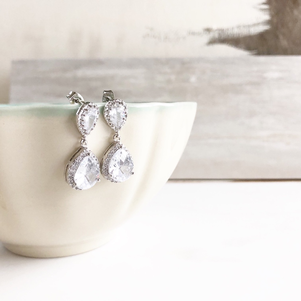 Silver cubic zirconia teardrop post earrings.