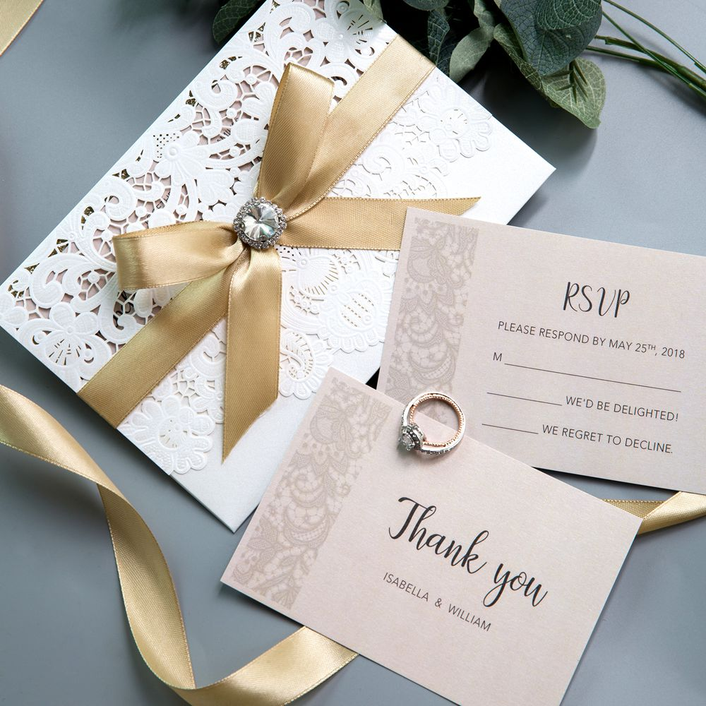 This delicate ivory laser cut wedding invitation features a luxury Belly Band of glittery gold ribbon row. Your guests will expect