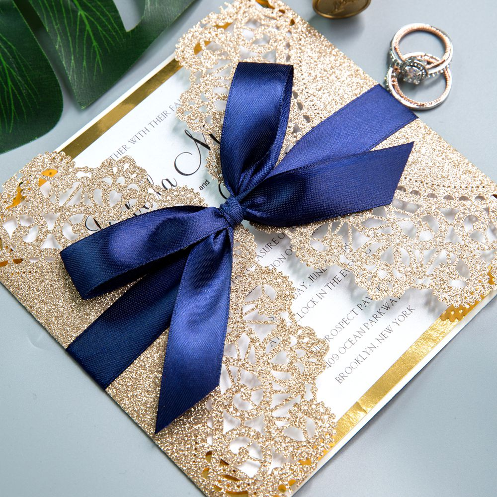 The great ensemble features a design of gold glitter laser cut wrap and navy blue ribbon.