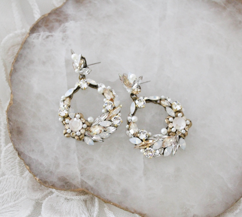 These lovely Swarovski crystal round hoop bridal earrings are created with antique gold components in a Bohemian style that will make