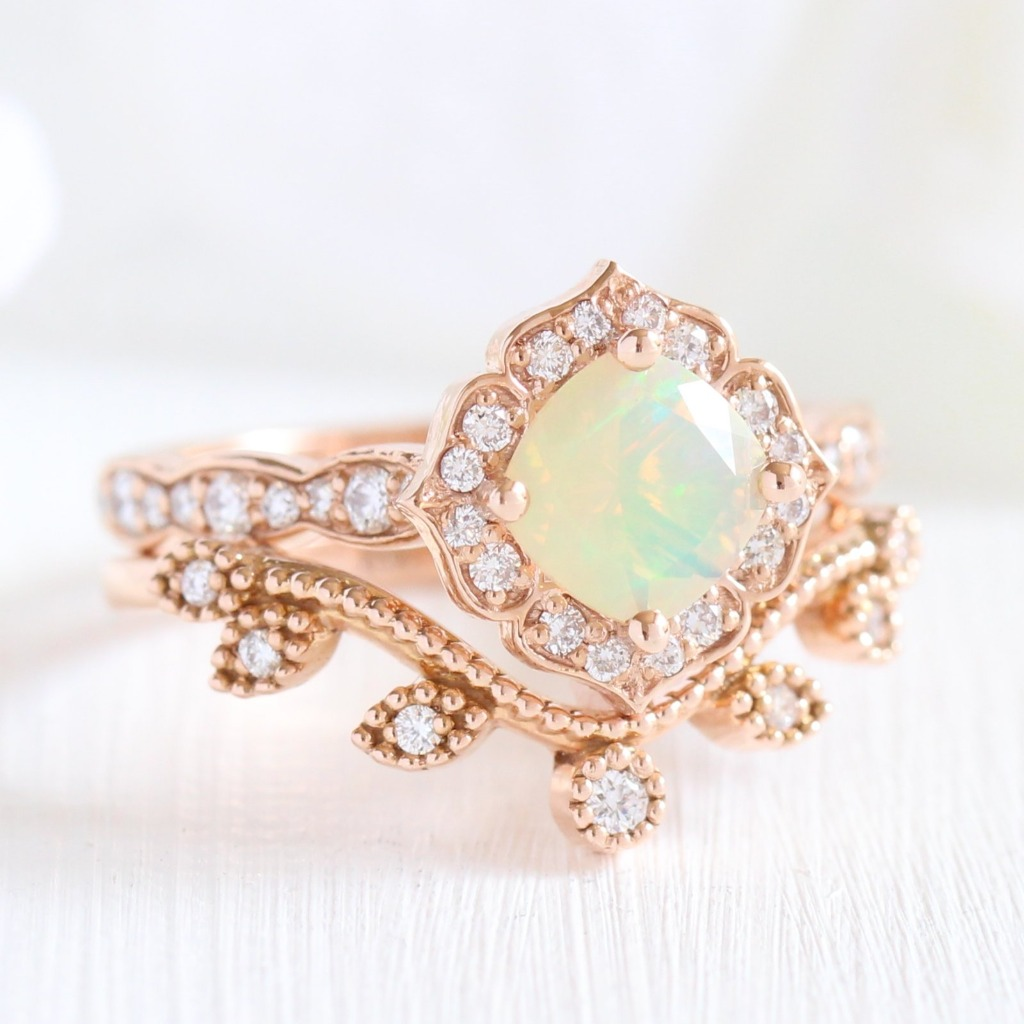 She's unique, she's delicate, she's opal! This unique bridal set features our Grace Solitaire Opal Engagement Ring with our Curved