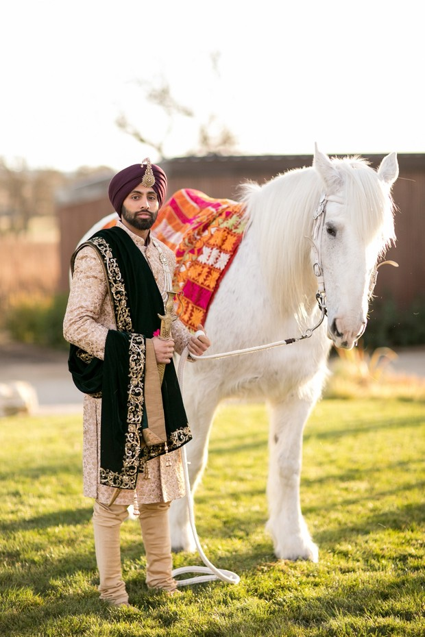 groom and white horse