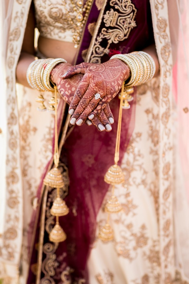 traditional bridal look with henna hands