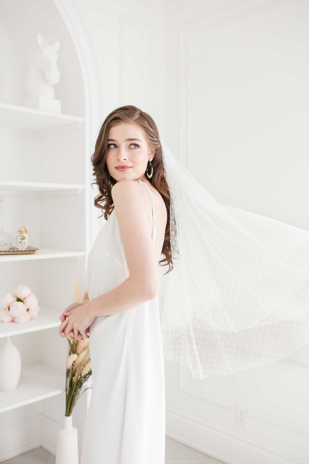 Timeless veil with embroidered dots.