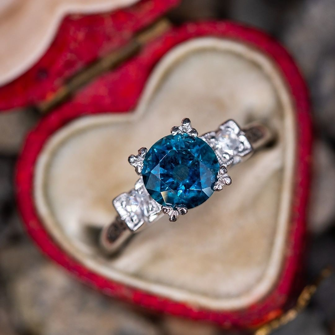 A beautiful Montana sapphire set in a vintage platinum fishtail setting with single cut diamond accents. .