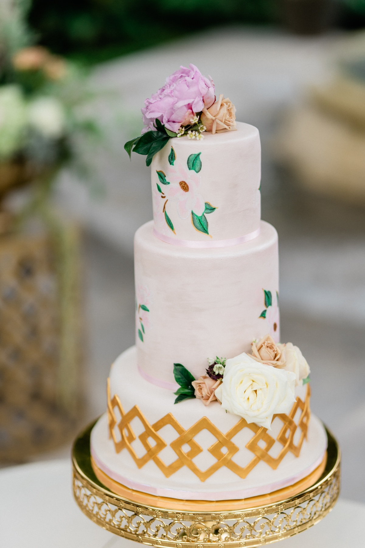 gold and floral wedding cake