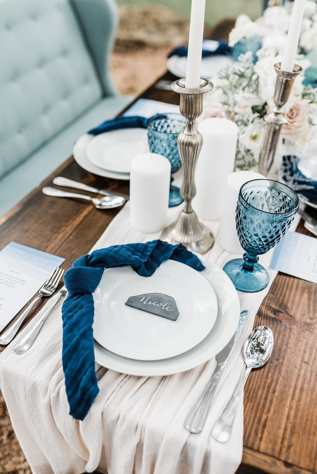 wedding place setting with blue accents