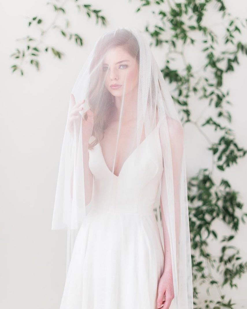 Our popular English net veil with blusher is available in multiple colors and lengths. Made with soft English net and is attached to